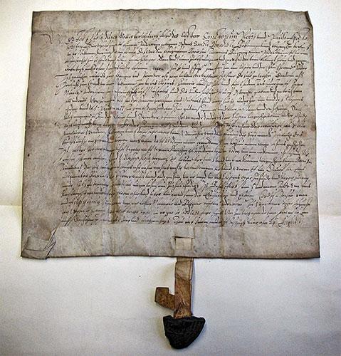 Urkunde mit Teil des Siegelabdrucks